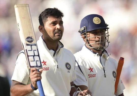 Murali Vijay (L) and Mahendra Singh Dhoni leave the field not out at the end of the first day's play in the first cricket test match against England at Trent Bridge cricket ground in Nottingham, England  July 9, 2014. REUTERS/Philip Brown