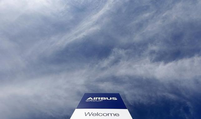 The logo of Airbus Group, Europe's largest aerospace group, is pictured in front of the company headquarters building in Ottobrunn, near Munich February 26, 2014. REUTERS/Michaela Rehle