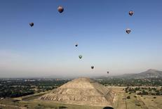 Hot air balloons float above the Pyramid of the Sun during the international hot air balloon festival in the pre-hispanic city of Teotihuacan, on the outskirts of Mexico City in this March 17, 2012 file photo. REUTERS/Henry Romero/Files