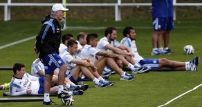Argentina's national soccer team coach Alejandro Sabella stands next to player Lionel Messi (L) and his teammates during a training session ahead of their 2014 World Cup final match against Germany in Vespasiano, July 10, 2014. REUTERS/Marcos Brindicci
