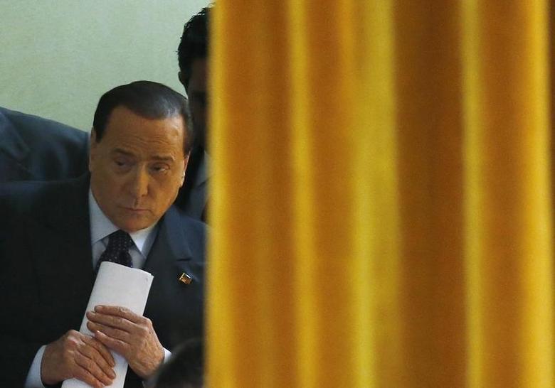 Forza Italia leader Silvio Berlusconi arrives for a party rally in Milan May 23, 2014. REUTERS/Alessandro Garofalo