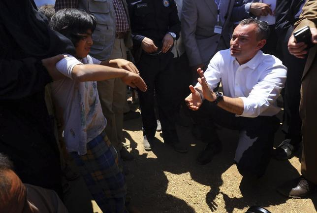 Nickolay Mladenov, the United Nations Secretary-General Special Representative for Iraq, visits a Iraqi refugee camp on the outskirts of Arbil in Iraq's Kurdistan region June 14, 2014. REUTERS/Stringer