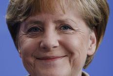 Chanceler alemã, Angela Merkel, reage a pergunta sobre a seleção da Alemanha em Berlim. 10/07/2014. REUTERS/Thomas Peter