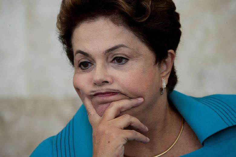 Brazil's President Dilma Rousseff reacts during a meeting of the Council for Economic and Social Development (CDES) at the Planalto Palace in Brasilia June 5, 2014. REUTERS/Ueslei Marcelino
