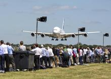 The Airbus Industrie A380 aircraft comes into land after its display at the 2014 Farnborough International Airshow in Farnborough, southern England July 14, 2014.    REUTERS/Kieran Doherty