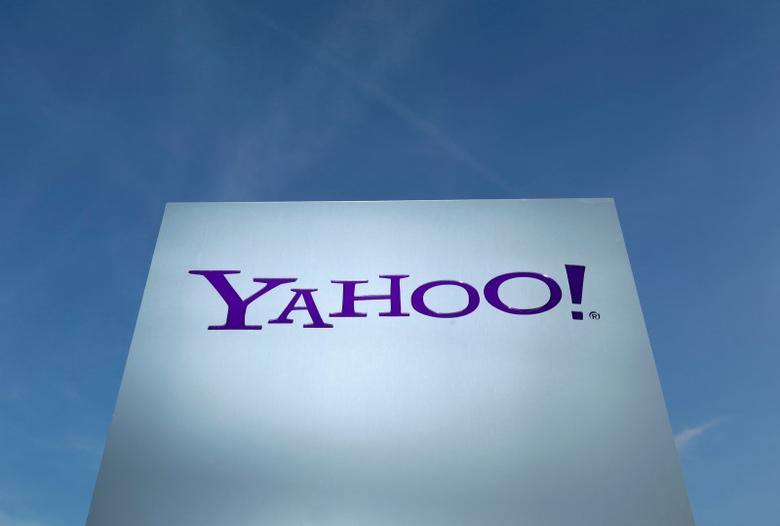 A Yahoo logo is pictured in front of a building in Rolle, 30 km (19 miles) east of Geneva, in this file picture taken December 12, 2012. REUTERS/Denis Balibouse/Files