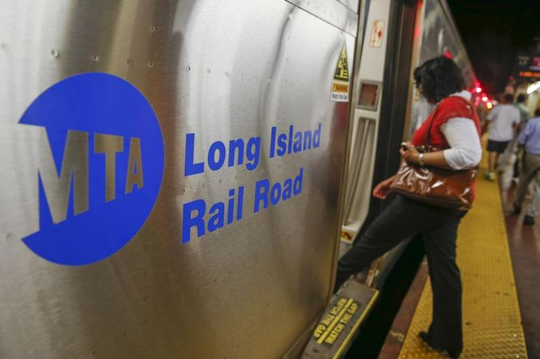 People board a Long Island Rail Road train at Pennsylvania Station in New York July 14, 2014. REUTERS/Shannon Stapleton