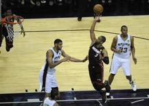Miami Heat guard Dwyane Wade (3) shoots against San Antonio Spurs forward Tim Duncan (21) in game five of the 2014 NBA Finals at AT&T Center. Jun 15, 2014; San Antonio, TX, USA; Brendan Maloney-USA TODAY Sports