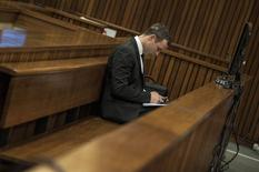 Olympic and Paralympic track star Oscar Pistorius attends his trial at the North Gauteng High Court in Pretoria July 7, 2014. REUTERS/Ihsaan Haffejee/Pool
