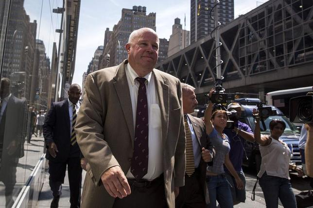 Metropolitan Transportation Authority (MTA) Chairman Thomas Prendergast (C) exits from a meeting between the MTA and Unions representing Long Island Rail Road workers, in New York July 16, 2014.    REUTERS/Brendan McDermid