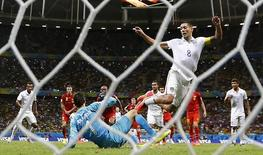 Clint Dempsey of the U.S. (8) is tackled by Belgium's goalkeeper Thibaut Courtois (on the ground) during extra time in their 2014 World Cup round of 16 game at the Fonte Nova arena in Salvador July 1, 2014.   REUTERS/Marcos Brindicci
