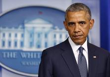 Президент США Барак Обама на пресс-конференции, посвященной ситуации на Украине, в Белом доме в Вашингтоне 16 июля 2014 года. Барак Обама в среду одобрил самый жёсткий до сих пор пакет санкций, бьющий по крупнейшему добытчику нефти в России, государственной Роснефти и некоторым другим энергетическим, финансовым и оборонным предприятиям, назвав это важными, но точечными наказаниями.   REUTERS/Larry Downing