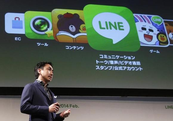 Takeshi Idezawa, chief operating officer of Line Corp, speaks during an announcement of its new service in Tokyo February 26, 2014.  REUTERS/Yuya Shino/Files