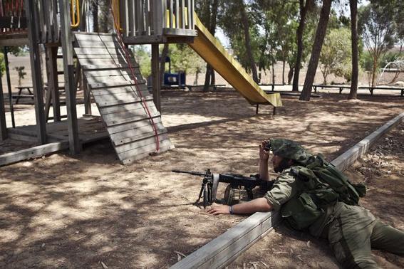 An Israeli soldier takes position outside the Gaza Strip July 19, 2014. REUTERS/Nir Elias