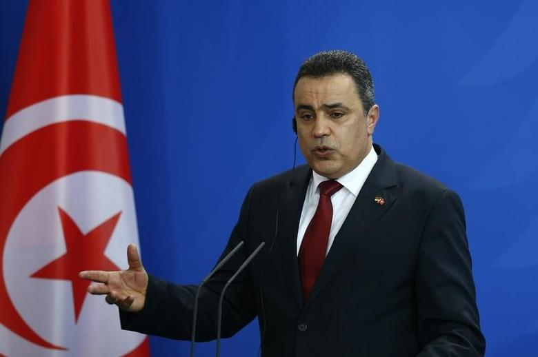 Tunisia's Prime Minister Mehdi Jomaa speaks during a news conference after talks with German Chancellor Angela Merkel at the Chancellery in Berlin, June 18, 2014. REUTERS/Thomas Peter