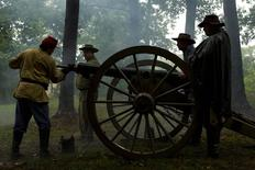 Civil War re-enactors fire a cannon every hour to commemorate the 150th anniversary of the Battle of Atlanta, in Atlanta, Georgia, July 19, 2014. REUTERS/Christopher Aluka Berry