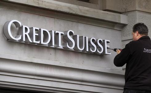 Credit Suisse posts big loss after U.S. tax settlement