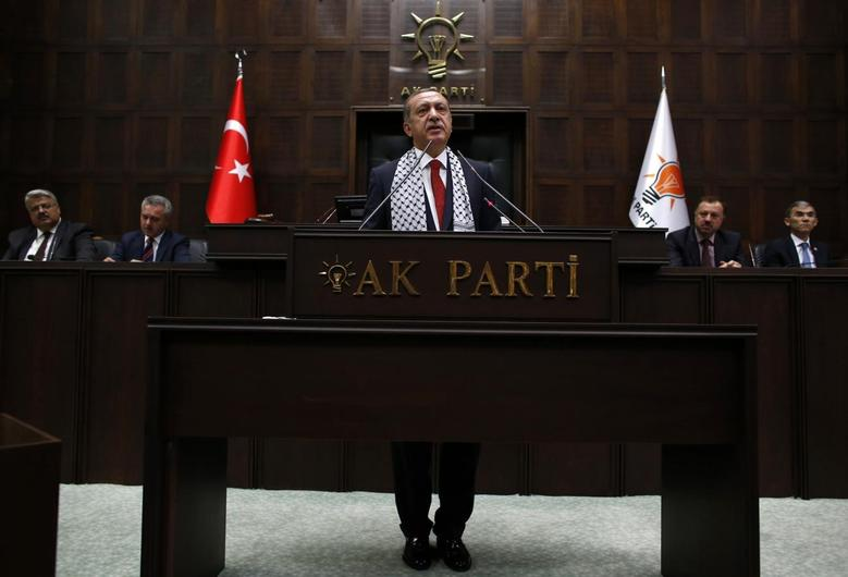 Turkey's Prime Minister Tayyip Erdogan addresses members of parliament from his ruling AK Party (AKP) during a meeting at the Turkish parliament in Ankara July 22, 2014. REUTERS/Umit Bektas