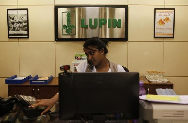 An employee of Lupin Limited works at a reception at their headquarters in Mumbai November 22, 2013.  REUTERS/Danish Siddiqui