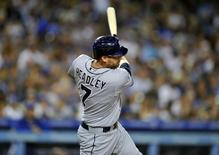 San Diego Padres third baseman Chase Headley (7) hits a single in the seventh inning against the Los Angeles Dodgers at Dodger Stadium. July 12, 2014; Los Angeles, CA, USA; Gary A. Vasquez-USA TODAY Sports