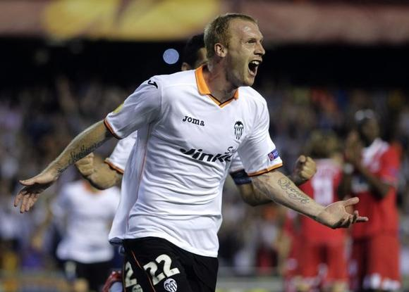 Valencia's Jeremy Mathieu celebrates after he scored against Sevilla during their Europa League semi-final second leg soccer match at the Mestalla stadium in Valencia, May 1, 2014. REUTERS/Heino Kalis/Files