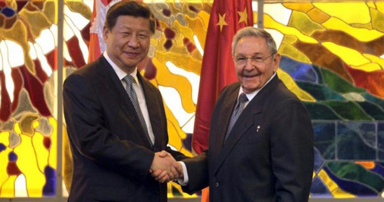 Cuba's President Raul Castro (R) shakes hands with China's President Xi Jinping during a meeting in Havana's Revolution Palace July 22, 2014.  REUTERS/Cubadebate/Handout via Reuters