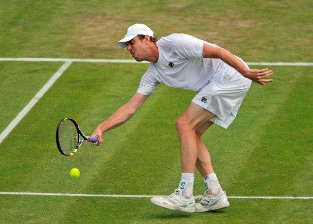 Jun 26, 2014; London, United Kingdom; Sam Querrey (USA) in action during his match against Jo-Wilfried Tsonga (FRA) on day three of the 2014 Wimbledon Championships at the All England Lawn and Tennis Club. Mandatory Credit: Susan Mullane-USA TODAY Sports
