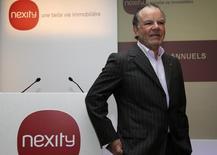 Alain Dinin, le PDG de Nexity. Le promoteur immobilier a enregistré un repli de 12,4% de son chiffre d'affaires pour le premier semestre du fait d'un environnement toujours difficile sur le marché de l'immobilier résidentiel et d'un fort recul de ses ventes dans l'immobilier d'entreprise. /Photo d'archives/REUTERS/Jacky Naegelen