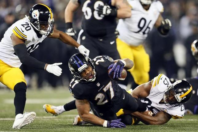 Baltimore Ravens running back Ray Rice (27) is tackled by Pittsburgh Steelers safety Ryan Clark (25) during a NFL football game on Thanksgiving at M&T Bank Stadium in Nov, 2013. USA TODAY Sports/Mitch Stringer