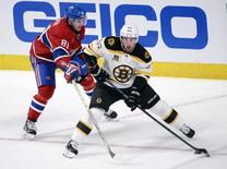 Boston Bruins forward Brad Marchand (63) plays the puck as Montreal Canadiens forward Lars Eller (81) defends during the third period in game six of the second round of the 2014 Stanley Cup Playoffs at the Bell Centre. May 12, 2014; Montreal, Quebec, CAN; Eric Bolte-USA TODAY Sports