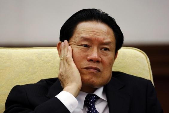 Then China's Public Security Minister Zhou Yongkang reacts as he attends the Hebei delegation discussion sessions at the 17th National Congress of the Communist Party of China at the Great Hall of the People in Beijing in this October 16, 2007 file photo.  REUTERS/Jason Lee/Files