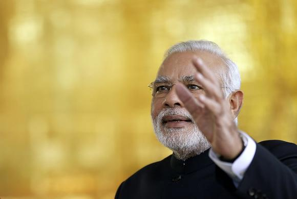 Prime Minister Narendra Modi reacts during a meeting with Brazil's President Dilma Rousseff (not pictured) on the sidelines of the 6th BRICS summit at the Alvorada Palace in Brasilia July 16, 2014. REUTERS/Ueslei Marcelino
