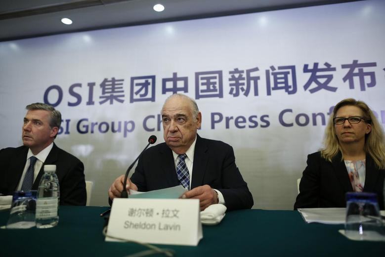 OSI Group Chairman and CEO Sheldon Lavin (C), OSI Group President and Chief Operating Officer David McDonald (L) and OSI Vice President of North America Quality Sharon Birkett attend a news conference in Shanghai, July 28, 2014. REUTERS/Aly Song
