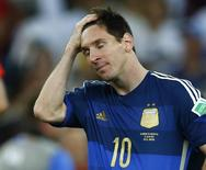 Argentina's Lionel Messi reacts after losing to Germany in their extra time in their 2014 World Cup final at the Maracana stadium in Rio de Janeiro  July 13, 2014.  REUTERS/Eddie Keogh