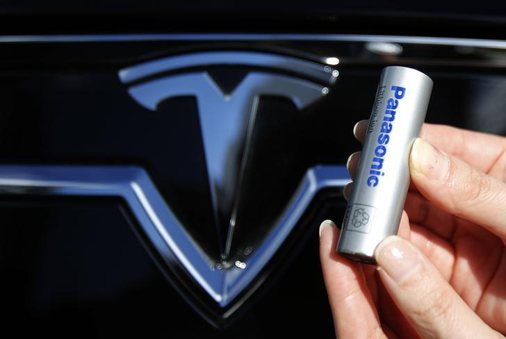 A Panasonic Corp's lithium-ion battery, which is part of Tesla Motor Inc's Model S and Model X battery packs, is pictured with Tesla Motors logo during a photo opportunity at the Panasonic Center in Tokyo, ahead of the 2013 Tokyo Motor Show, November 19, 2013. REUTERS/Yuya Shino