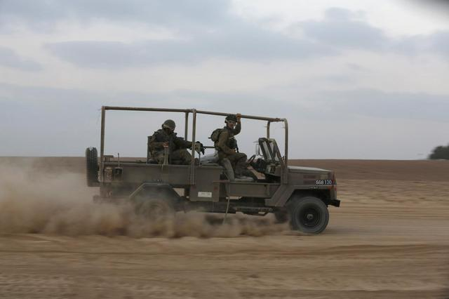 Israeli soldiers ride a military vehicle near Kibbutz Nahal Oz, outside the northern Gaza Strip July 28, 2014. REUTERS/Baz Ratner