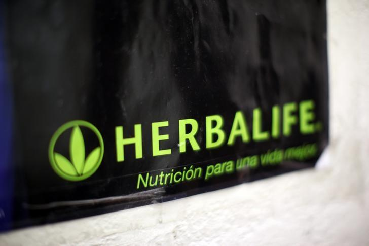 A Herbalife logo is shown on a poster at a clinic in the Mission District in San Francisco, California April 29, 2013.  REUTERS/Robert Galbraith