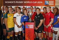 Team captains (L-R) Anna Yakovleva of Kazakhstan, Shannon Parry of Australia, Shaina Turley of the U.S., Katy McLean of England, Fiona Coghlan of Ireland, Gaelle Mignon of France, Kelly Russell of Canada, Fiao'o Faamausili of New Zealand, Ana Maria Aigneren of Spain,  Rachel Taylor of Wales, and Cynthia Ta'ala of Samoa pose after a news conference for the official launch of the Women's Rugby World Cup 2014 at the Hotel de Ville in Paris July 29, 2014.  REUTERS/Benoit Tessier