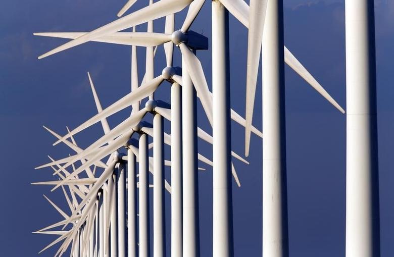 Power-generating windmill turbines are seen near Port Saint Louis du Rhone, near Marseille, May 7, 2014.  REUTERS/Jean-Paul Pelissier