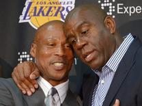 Jul 29, 2014; El Segundo, CA, USA; Byron Scott (left) is embraced by Magic Johnson at a press conference to introduce Scott as Los Angeles Lakers coach at Toyota Sports Center. Kirby Lee-USA TODAY Sports