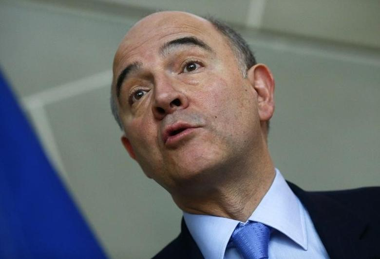 Pierre Moscovici speaks to media after an official meeting with Swiss Finance Minister Eveline Widmer-Schlumpf in Bern March 6, 2014. REUTERS/Ruben Sprich