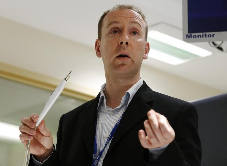 Inventor of the Intelligent Knife, Zoltan Takats, speaks to the media at St Mary's Hospital in London July 17, 2013. Scientists have developed an ''intelligent knife'' that can tell surgeons immediately whether the tissue they are cutting is cancerous or not.     REUTERS/Luke MacGregor