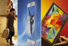 Samsung Electronics a dégagé sur la période avril-juin un bénéfice d'exploitation en baisse de 24,6%, à son plus bas niveau depuis deux ans. Le groupe sud-coréen, confronté à une féroce concurrence, a évoqué des prévisions incertaines pour son activité clé de téléphonie mobile pour le prochain trimestre. /Photo prise le 30 juillet 2014/REUTERS/Kim Hong-Ji