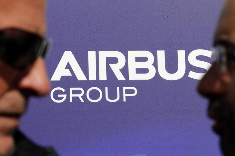 Visitors walk past the logo of Airbus Group during the e-Aircraft Day at the Bordeaux Merignac airport, southwestern France, April 25, 2014.   REUTERS/Regis Duvignau