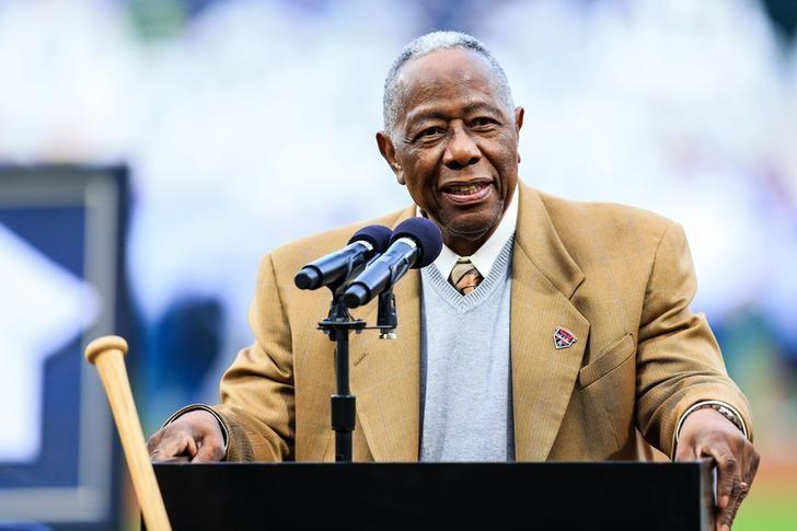 Former Atlanta Brave Hank Aaron speaks during a ceremony honoring the 40th anniversary of his 715th home run before the game against the New York Mets at Turner Field ON aPRIL 8, 2014. USA TODAY Sports/Daniel Shirey