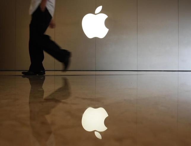 A man walks past the logo at an Apple store in the southern Chinese city of Shenzhen, neighbouring Hong Kong September 9, 2013.  REUTERS/Bobby Yip /Files