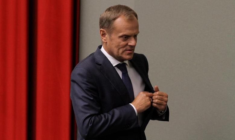Poland's Prime Minister Donald Tusk walks after voting at parliament in Warsaw July 11, 2014. The Polish parliament on Friday rejected a motion of no confidence in the government of Prime Minister Tusk. REUTERS/Slawomir Kaminski/Agencja Gazeta