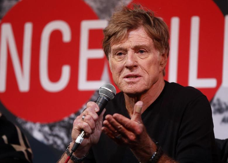 Actor Robert Redford addresses the media at an opening day news conference for the Sundance Film Festival at the Egyptian Theatre in Park City, Utah, in this January 16, 2014 file photo.   REUTERS/Jim Urquhart/Files