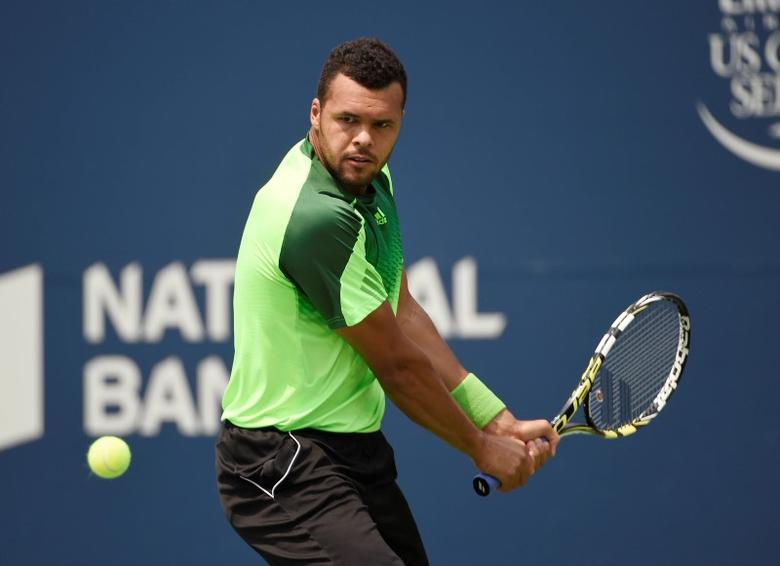 Aug 8, 2014; Toronto, Ontario, Canada; Jo-Wilfried Tsonga (FRA) plays a backhand against Andy Murray (GBR) on day five of the Rogers Cup tennis tournament at Rexall Centre.  Peter Llewellyn-USA TODAY Sports