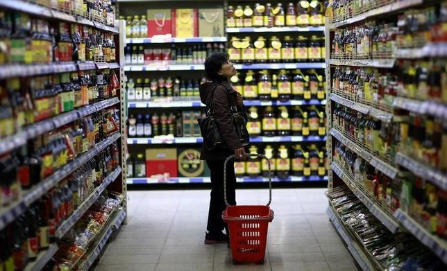 A customer looks at items displayed on shelves at a supermarket in Shenyang, Liaoning province April 11, 2014. REUTERS/Stringer